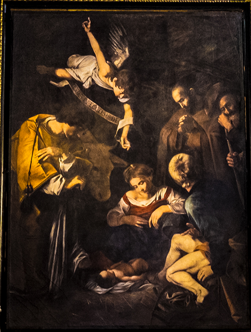 Natività con S. Lorenzo e S. Francesco di Caravaggio