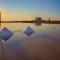 Alle Saline di Trapani raccolta del sale al tramonto